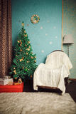 Christmas interior - tree and rocking chair Stock Image