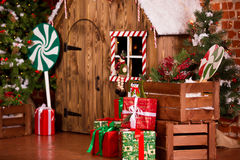 Christmas interior with wooden house, candy, tree and gifts. No people. Holiday background Stock Photography