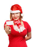 Christmas invitation. Beautiful young woman in christmas suit holding advertisement card isolated on white background Stock Photo