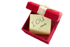 Christmas IOU. Sign of the Times: Empty Gift Box with IOU from Santa Stock Image