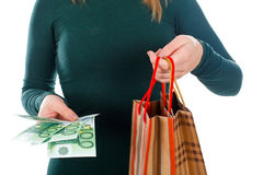 Christmas isn`t about the money. Close up picture of a woman holding a Christmas gift and money Stock Photo