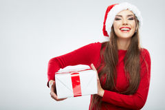 Christmas isolated woman portrait hold christmas gift. Royalty Free Stock Photography
