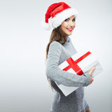 Christmas isolated woman portrait hold christmas gift. Royalty Free Stock Images