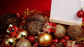 Christmas items in red and gold theme with white board standing for write wording Royalty Free Stock Image