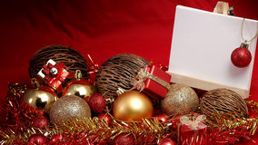 Christmas items in red and gold theme with white board standing for write wording Royalty Free Stock Photo