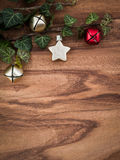 Christmas, ivy, christmas decorations, stars and bells Stock Photography