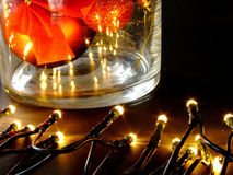 Christmas Jar with Lights. Jar with Christmas Baubles and Lights on the Table Stock Images