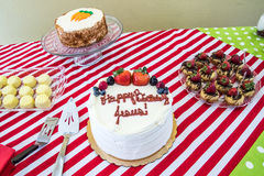 Christmas Jesus cake with other desserts Stock Images
