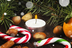 Christmas jewelry - candles, fir-tree branches, nuts, cinnamon, Royalty Free Stock Image