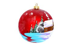 Christmas jewelry for a New Year tree. Christmas jewelry and toys - a ball for a New Year tree, a winter lodge and trees, a place for the text, isolated on a Stock Photos