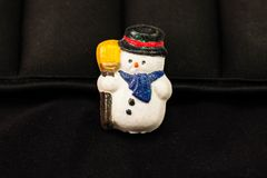Christmas jewelry snowman with broom and scarf pin. A christmas jewelry snowman with broom and scarf pin Royalty Free Stock Photo