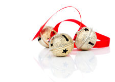 Christmas jingle bell with red ribbon Stock Photos