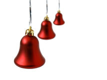 Christmas jingle-bells. Three red Christmas jingle-bells are isolated on white Stock Photography