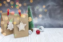 Free Christmas Jingle Bells And Paper Gift Bags On Festive Background Royalty Free Stock Photography - 130046707