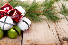 Christmas Jingle bells and a pine branch Royalty Free Stock Image