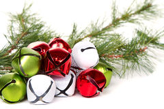 Christmas jingle bells and pine branch Royalty Free Stock Images