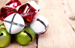 Christmas jingle bells on a  plank Royalty Free Stock Images