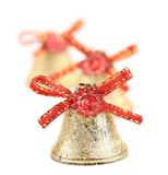 Christmas jingle bells with red ribbon. Royalty Free Stock Photos
