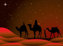 Christmas journey. Traditional christmas scene with camels and a starry sky Royalty Free Stock Images