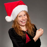 Christmas Joy. Silly young girl wearing a christmas hat and smiling stock images