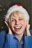 Christmas joy. Girl smiling with santa hat Stock Photography