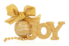 Christmas Joy. Glitter sign, gold and silver bauble with bow and bead chain over white background Royalty Free Stock Photography