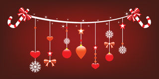 Christmas joy with cheerful hanging ornaments. Royalty Free Stock Photo