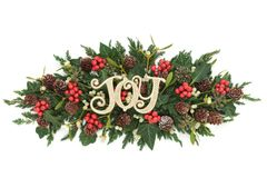 Christmas Joy Decoration. With holly, ivy, mistletoe, fir and pine cones on white background Stock Photo