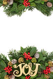 Christmas Joy and Floral Border. Christmas border with joy sign decoration, flora of holly and berries, ivy, snow covered pine cones, cedar cypress and fir leaf Stock Photography