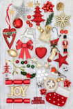 Christmas Joy Sign and Decorations. Christmas gold glitter joy sign, with new and old fashioned bauble decorations, holly, mistletoe, fir and mince pie on royalty free stock images