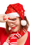 Christmas joy. Young woman in new year or christmas suit sly smiling isolated on white background Royalty Free Stock Photography