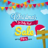 Christmas in July fest, sale banner, poster or flyer design with. Bunting flags, Santa hat and upto 70% off offers on blue background Royalty Free Stock Photography