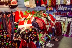 Christmas jumpers on sale. Whitchurch, Bristol, UK - November 19, 2016:  Christmas jumpers on sale in Whitehall  garden centre, near Lacock in Wiltshire, United Royalty Free Stock Image