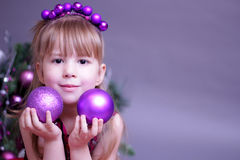 Christmas kid with decorations Royalty Free Stock Photos