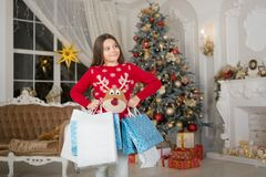 Christmas. Kid enjoy the holiday. The morning before Xmas. New year holiday. girl with shopping bags. Happy new year. Little child girl likes xmas present stock photos