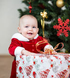 Christmas kid girl with big gift Royalty Free Stock Images
