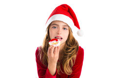 Christmas kid girl eating Xmas Santa cookie Royalty Free Stock Images