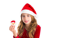 Christmas kid girl holding Xmas Santa cookie Royalty Free Stock Images