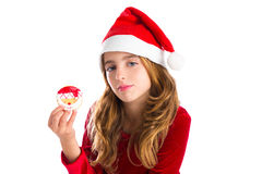 Christmas kid girl holding Xmas Santa cookie Stock Images