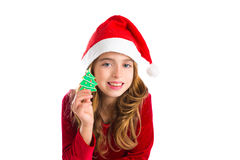 Christmas kid girl holding Xmas tree cookie Royalty Free Stock Photos