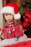Christmas kid holding present Stock Photos