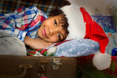 Christmas kid laying near presents. Royalty Free Stock Photo