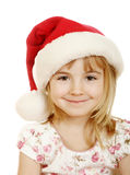 Christmas kid in Santa hat. On white background Stock Photos