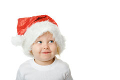 Christmas kid in Santa hat Stock Photos