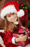 Christmas kid smiling and holding gift Stock Photography