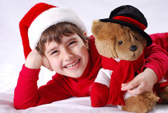 Christmas Kids. Christmas kid in Santa hat with teddy bear Royalty Free Stock Photo