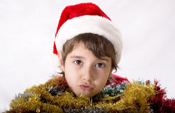 Christmas Kids. Christmas kid in Santa hat with christmas decoration Royalty Free Stock Photos
