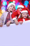 Christmas kids with a banner Royalty Free Stock Images