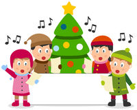 Christmas Kids and Banner. A group of four cute kids singing Christmas carols in front of a Christmas tree, with a blank banner. Empty space for your message Stock Photo