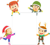Christmas kids with blank sign Stock Photo